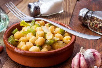 casserole of homemade stewed chickpeas on rustic board