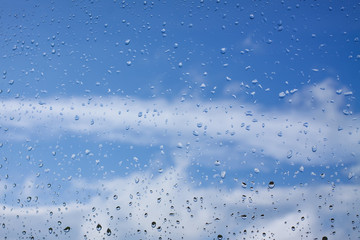 Water drops after rain on window glass surface.