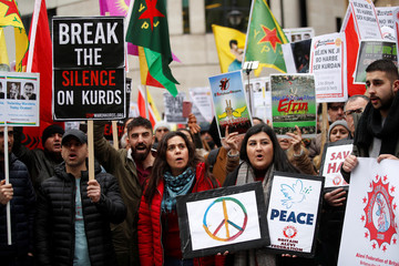 Pro-Kurd protesters demonstrate their support at a rally in central London
