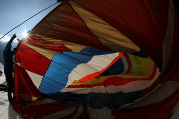A Participant prepares a balloon for inflation during the International Hot Air Balloon Week in Chateau-d'Oex