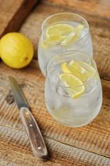 Fresh lemonade with ice and lemon on the table
