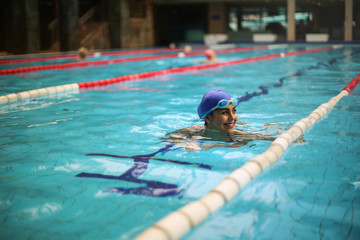 Smiling swimmer training