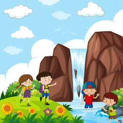 Four kids by the waterfall