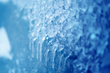 Photo background of bright icicles and ice floes