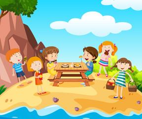 Happy kids having lunch on island