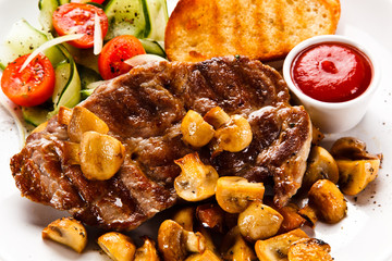 Grilled steak with toasts and vegetables on white background