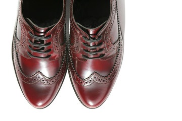Brogues of brown genuine leather on a white background. Brown Oxford Shoes. fashion footwear