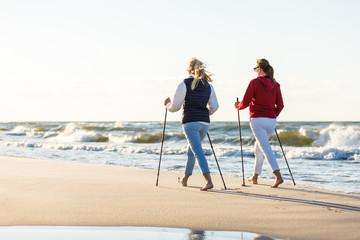 Obraz Nordic walking - active people working on beach - fototapety do salonu