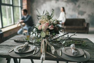 Festive decorated table for two on blurred newlyweds background