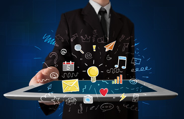 Businessman holding tablet with apps