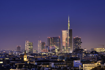 In de dag Milan Milan skyline by night, new skyscrapers with colored lights. Italian landscape panorama.