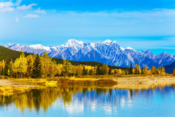 Rocky Mountains are reflected in the Abraham lake