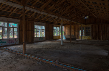 Interior of an abandoned building with broken windows