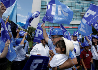 Presidential candidate the National Integration Party (PIN), Juan Diego Castro holds up girl during a campaign rally in San Jose