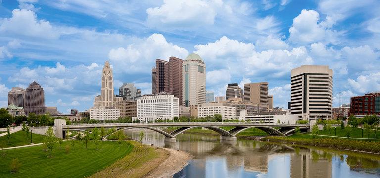 Beautiful skyline of Columbus Ohio with bridge and water reflection