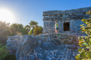 Kid on the top of antique ruins