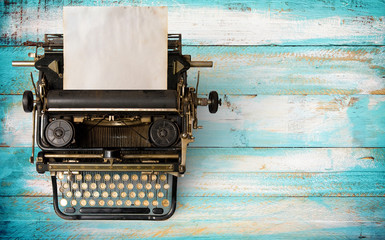 Vintage typewriter header with old paper. retro machine technology - top view and creative flat lay design. Fototapete