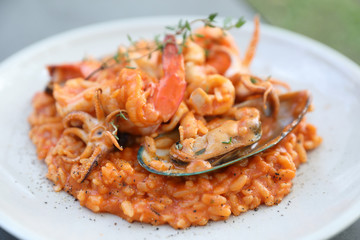 seafood risotto with mussel shrimp and squid , italian food