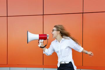 Girl activist yelling at loudspeaker