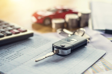 car key with money and calculator on table. concept finance and insurance