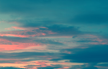 Beautiful colorful sky with clouds and sunlight. Color toned.