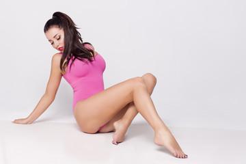 beautiful sexy girl in body, underwear in studio over white background
