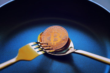 Everyone wants bitcoin, Digital currency physical gold bitcoins on dish, Cryptocurrency Coin under the fork and spoon, Blockchain Transaction System Crisis Concept