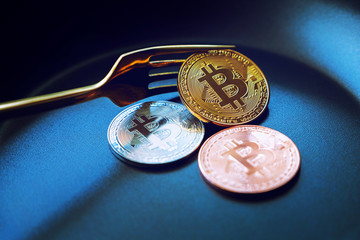 Everyone wants bitcoin, Digital currency physical three bitcoins on dish, Cryptocurrency Coin under the fork, Blockchain Transaction System Crisis Concept