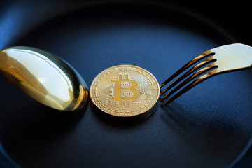 Everyone wants bitcoin, Digital currency physical gold bitcoins on dish with spoon, Cryptocurrency Coin under the fork, Blockchain Transaction System Crisis Concept