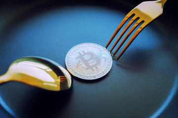 Everyone wants bitcoin, Digital currency physical silver bitcoins on dish with spoon, Cryptocurrency Coin under the fork, Blockchain Transaction System Crisis Concept