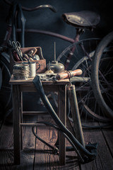 Old bike fix service with tools, wheels and tube