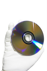 Hand in a white glove holding the compact disc CD. Isolated on white background