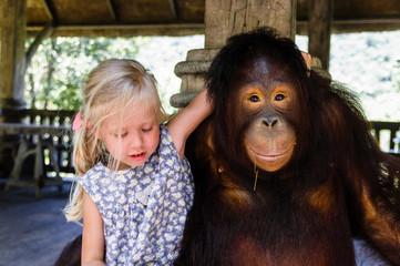 blond girl hugging a big monkey