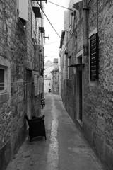 Old narrow stone street inside Milna old town, Croatia