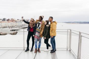 Friends taking selfie in harbor