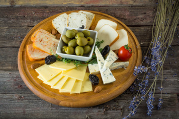 Cheese plate. On a wooden background. Top view. rustic food