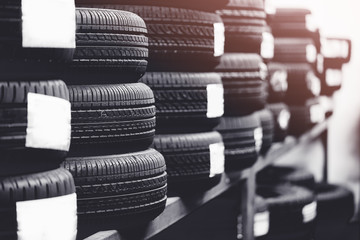 Tires for sale at a tire store.Black and white tone. Wall mural