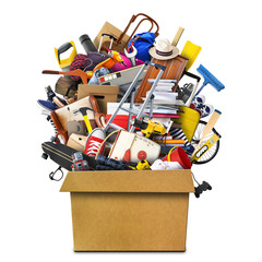 Large pile of household things in a box