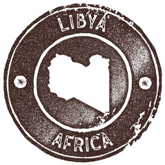 Libya map vintage stamp. Retro style handmade label, badge or element for travel souvenirs. Brown rubber stamp with country map silhouette. Vector illustration.