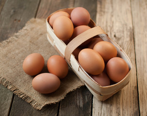 chicken eggs in wooden basket