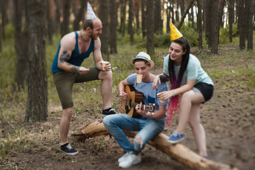 Friends guitar music picnic party nature concept. Traveler lifestyle. Hiking happy moments.
