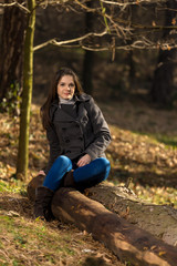 young woman in the forest posing