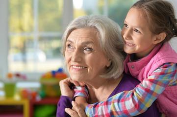 little girl hugging her grandmother