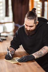 Portrait of professional creative tattoo master