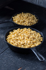 baked macaroni and cheese noodles in rustic cast iron dish