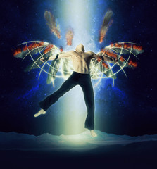 A man with wings on a background of dark sky