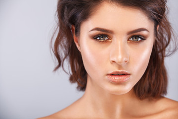 Closeup portrait of beautiful young woman with clean and fresh skin. Nude makeup. Facial treatment . Concept for cosmetology, beauty and spa .