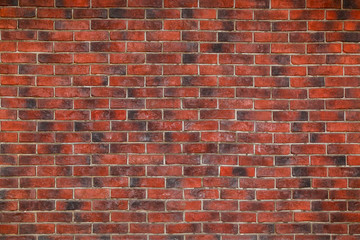 Background in the form of a wall from a red brick