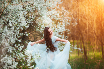 Spring smile. Happy beautiful smiling young woman in blossom park ... 3a4f4fe7d