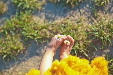 sun flowers chamomile girl little skirt holds fingers